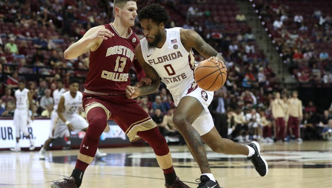 FSU's Phil Cofer drives past Boston College's Luka Kraljevic during their game at the Tucker Civic Center on Saturday, March 3, 2018.