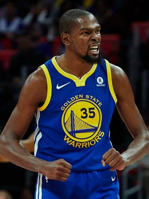 Golden State Warriors forward Kevin Durant (35) celebrates after the third quarter against the Detroit Pistons at Little Caesars Arena.