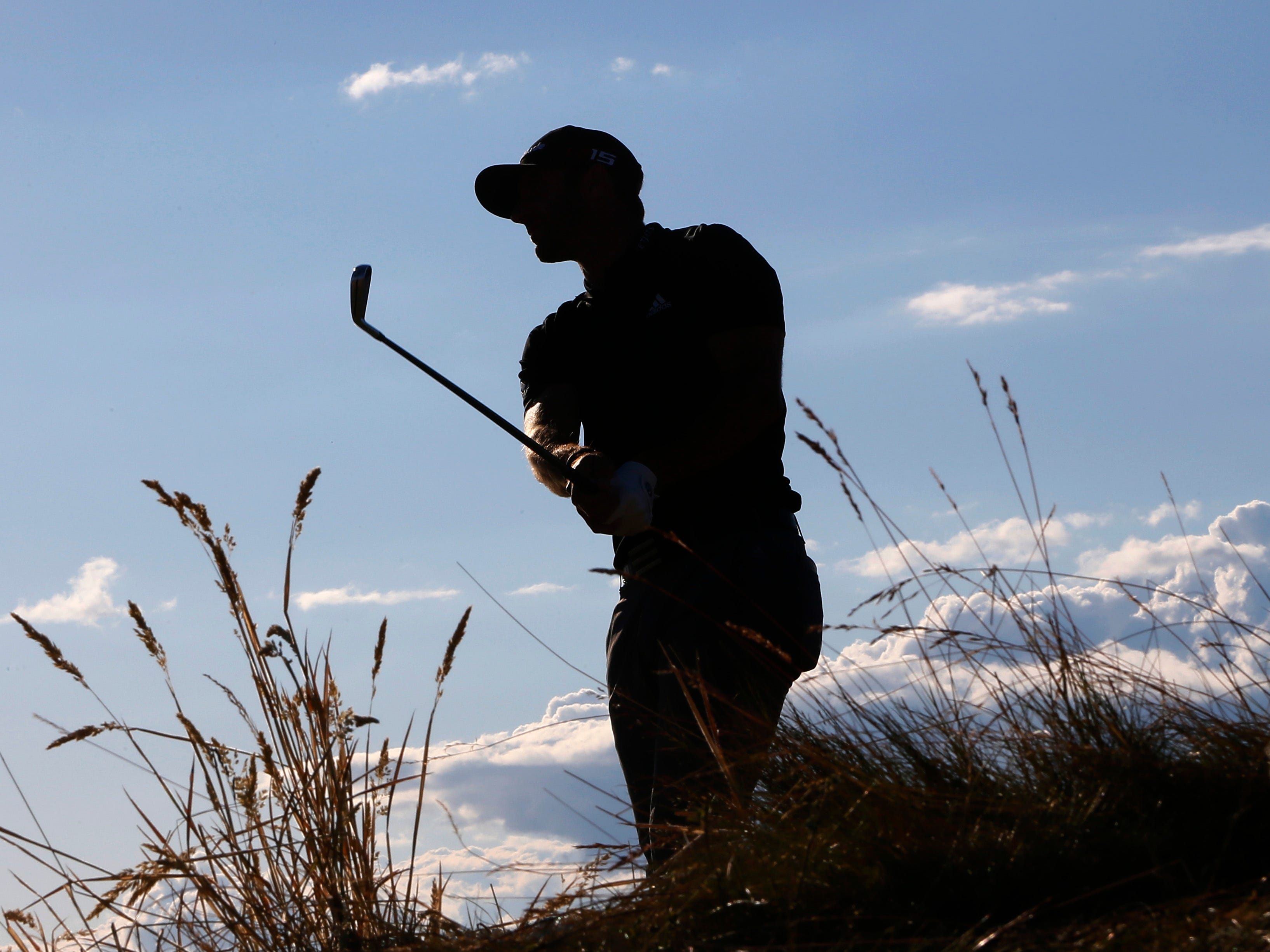 Dustin Johnson watches his tee shot on the 16th hole during the second round of the U.S. Open golf tournament at Chambers Bay on Friday, June 19, 2015 in University Place, Wash. (AP Photo/Matt York)