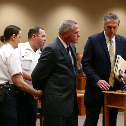 Daniel Lynch handcuffed after being sentenced.