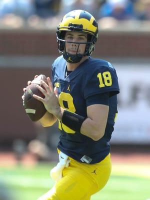 Michigan quarterback Brandon Peters looks to pass in the spring game Saturday, April 15, 2017 at Michigan Stadium in Ann Arbor.