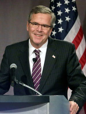 Former Florida Gov. Jeb. Bush speaks to the Chicago Council on Global Affairs on Feb. 18 in Chicago. Most voters don't really care about campaign finance, but raking in cash is an essential skill for any successful candidate, and Bush is in a position to do just that.