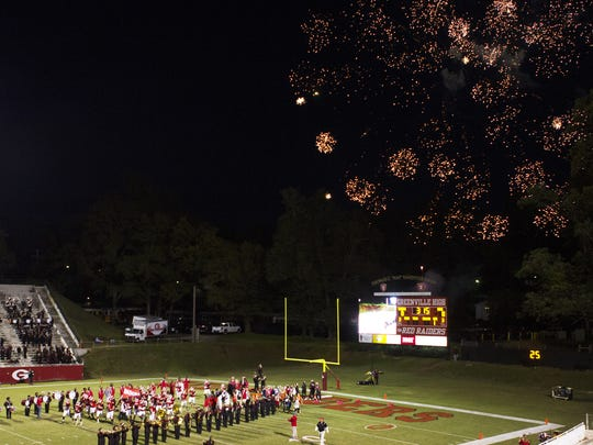 Fireworks go off as the Greenville High School Red Raiders ready to play on Friday night.