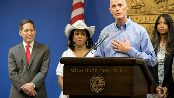 Florida Gov. Rick Scott, foreground, speaks during a news conference along with Centers for Disease Control and Prevention Director Dr. Tom Frieden, left, Rep. Frederica Wilson, D-FL, and Fla. Surgeon General and Secretary, Dr. Celeste Philip, far right, Thursday, Aug. 4, 2016, in Doral, Fla. The CDC has warned expectant mothers to steer clear of the city's Wynwood neighborhood, where at least 15 people are believed to have been infected with the Zika virus through mosquito bites in the first such cases on record in the mainland U.S. (AP Photo/Wilfredo Lee)