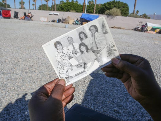 Now homeless, Sherwin Goynes holds a picture of himself