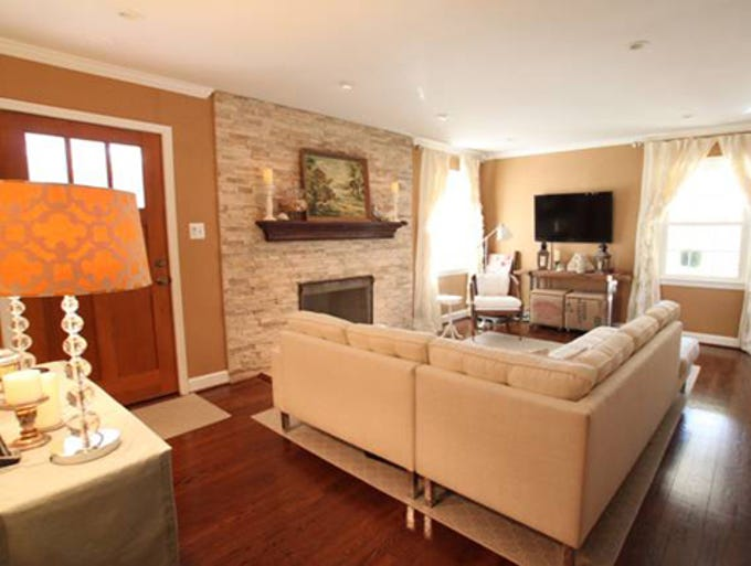 Heather and Dave Thibodeau of Ijamsville, Md., remade their fireplace, replaced the front door, refinished the hardwoods, added recessed lighting and updated the decor.