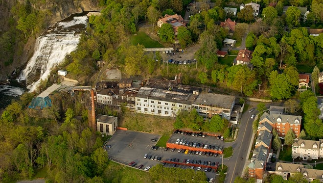 The former Ithaca Gun factory in May of 2009 prior to the demolition of the factory. The structure is seen in an aerial view looking to the east with Ithaca Falls at the top left and the Gun Hill Apartments at the lower right.