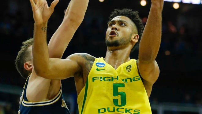 Mar 23, 2017; Kansas City, MO, USA; Oregon Ducks guard Tyler Dorsey (5) goes up for a shot as Michigan Wolverines guard Duncan Robinson (22) defends during the second half in the semifinals of the midwest Regional of the 2017 NCAA Tournament at Sprint Center. Mandatory Credit: Jay Biggerstaff-USA TODAY Sports