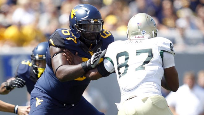 Offensive left guard Quinton Spain (67) is a leading contender for all-Big 12 honors.
