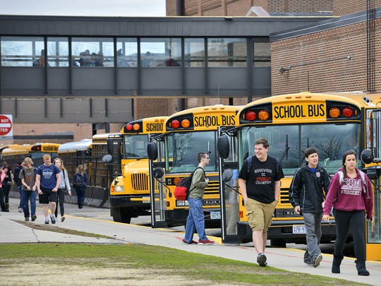 Students leave Technical High School for their buses Tuesday, April 29, 2014, in St. Cloud.