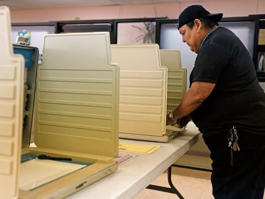 A voter casts a ballot in the Navajo Nation special election on April 21 at the Tse Daa Kaan Chapter House in Hogback.