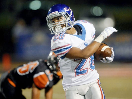 Spring Grove's L.J. Chisholm runs with the ball during the second half Friday at York Suburban. The Rockets fell to the Trojans, as each team now stands at 1-2 on the year.