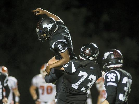 South Western's Mike Johnson celebrates after scoring a touchdown in a win against Central York. The Mustangs have an opportunity to separate themselves from the YAIAA Division I pack in the next two weeks with back-to-back games against Red Lion and Dallastown.