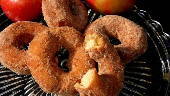 Spiced Apple Cider Doughnuts are easy to make at home.