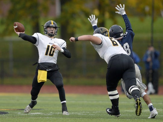McQuaid's Hunter Walsh throws a pass from the pocket