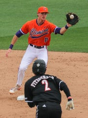 Clemson freshman shortstop Logan Davidson (8) forces out Louisville runner Tyler Fitzgerald during the top of the fourth inning on Friday at Doug Kingsmore Stadium in Clemson.