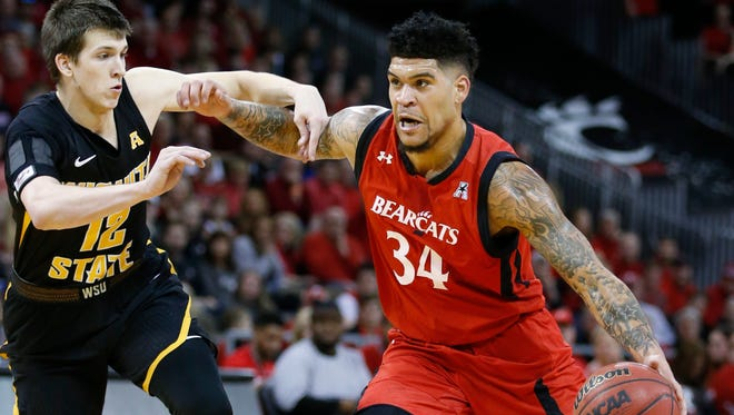 Cincinnati guard Jarron Cumberland drives to the basket against Wichita State guard Austin Reaves during the first half of Sunday's game in Highland Heights, Ky.