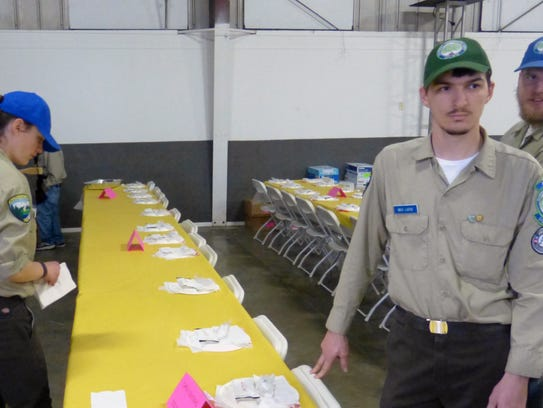 Members of the California Conservation Corps help set
