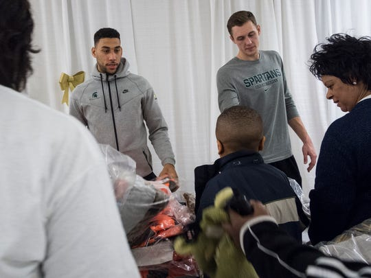 MSU basketball players Denzel Valentine, left, and