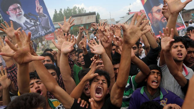 Kashmiri Shia Muslims shout anti America and anti Israel slogans during a protest on the outskirts of Srinagar, India. Dozens of Shia Muslims in Indian portion of Kashmir protested against the al-Qaida breakaway group Islamic State of Iraq and the Levant (ISIL) after Friday prayers. Over the past week, militants have overrun the Iraqi town of Mosul and seized wide swathes of territory as they storm toward Baghdad.