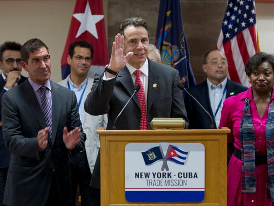 New York Gov. Andrew Cuomo waves as he and his delegation