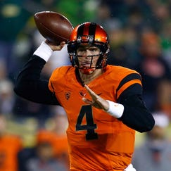 EUGENE, OR - NOVEMBER 29:  Quarterback Sean Mannion #4 of the Oregon State Beavers looks to throw a pass against the Oregon Ducks during the 117th playing of the Civil War on November 29, 2013 at the Autzen Stadium in Eugene, Oregon.  (Photo by Jonathan Ferrey/Getty Images)