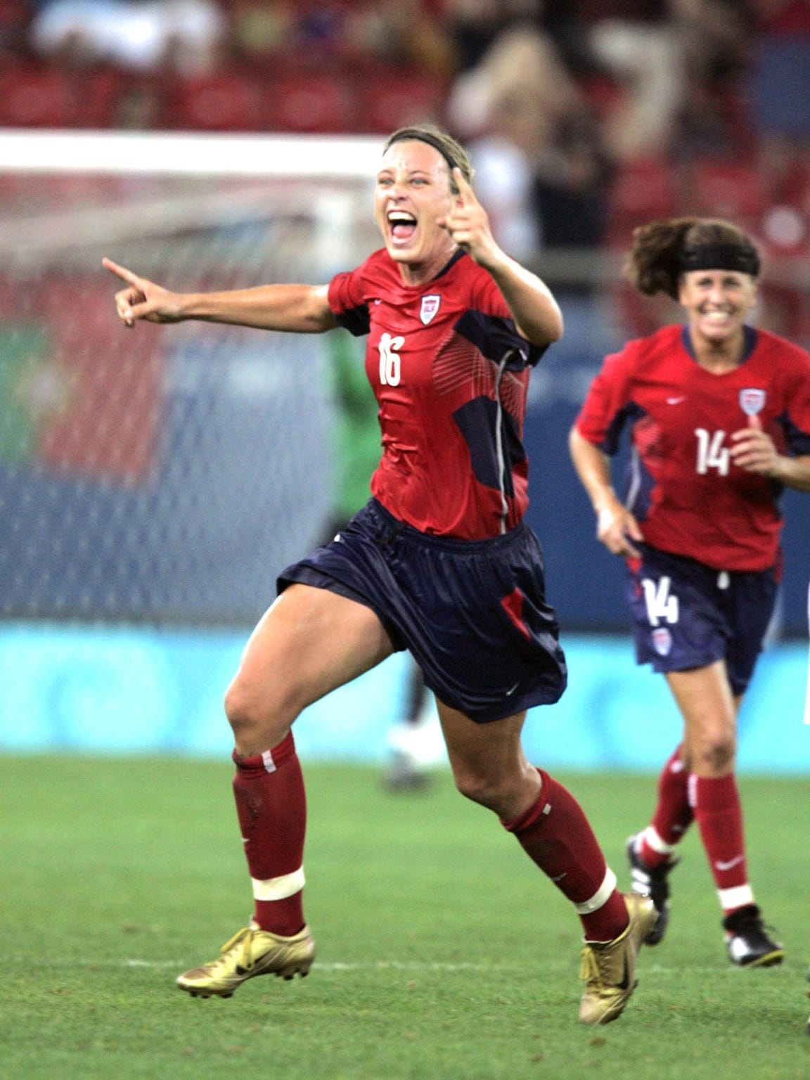 Abby Wambach runs across the field after scoring in overtime of the gold medal match against Brazil in the 2004 Olympics in Athens, Greece.