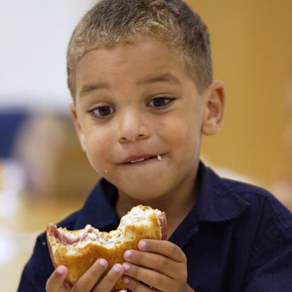 Four-year-old Julian Johnson eats his lunch at the Loop Lab School in Chicago, Illinois.