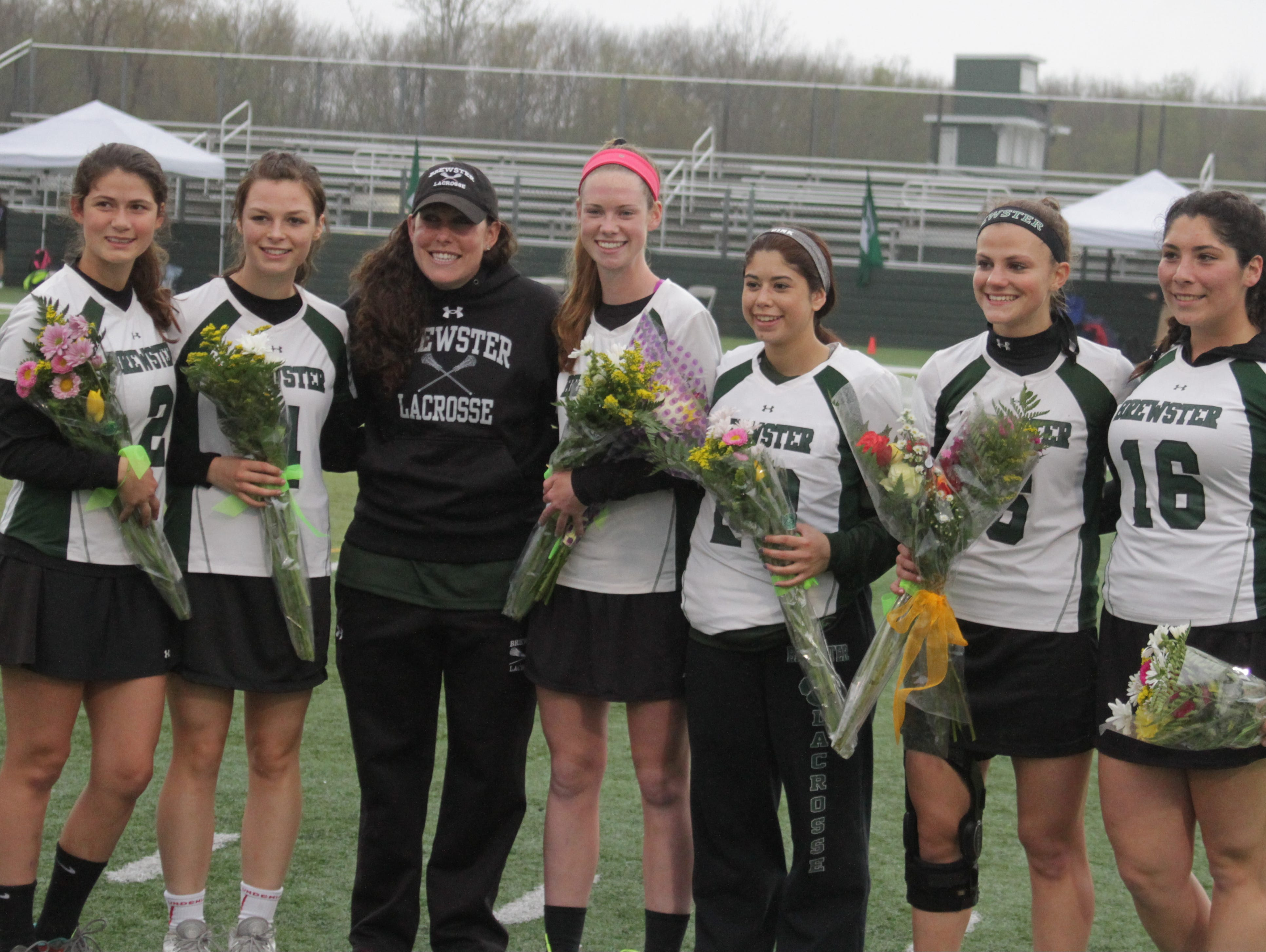 Brewster's six seniors pose after the Senior Day ceremony before a game against John Jay at Brewster on Friday, May 6th, 2016. From left: Emma Lambert, Ailish Erickson, head coach Sara DiDio, Kathleen Regan, Danielle Minella, Mary Kate Lonegan and Taylor Doria.