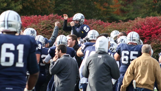 Monmouth University kicker Matt White (49) is lifted on his teammates' shoulders after kicking the game-winning field goal in overtime against Liberty on Saturday