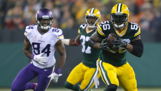 Green Bay Packers outside linebacker Julius Peppers intercepts a pass against Minnesota Vikings wide receiver Cordarrelle Patterson and runs it back for a touchdown in the second quarter.