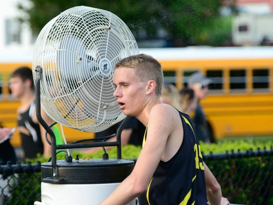 Colonel Crawford sophomore Chad Johnson cools down after winning the 3200 meter run in Friday's Division III regional meet at Tiffin Columbian.