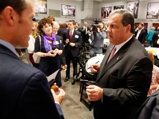 New Jersey Gov. Chris Christie talks with business leaders after speaking at the Politics and Eggs breakfast meeting at the New Hampshire Institute of Politics at Saint Anselm College, Tuesday, June 9, 2015, in Manchester, N.H. Christie is finishing a two-day swing through the nation's earliest presidential primary state as he considers a run for the Republican nomination for president. (AP Photo/Jim Cole)
