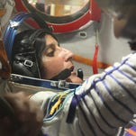 "On July 3, 2012, at the Baikonur Cosmodrome in Kazakhstan, Expedition 32 Flight Engineer Sunita Williams of NASA works through procedures in the Soyuz TMA-05M spacecraft during a suited ""fit check"" of the vehicle in which she, Soyuz Commander Yuri Malenchenko and Flight Engineer Aki Hoshide of the Japan Aerospace Exploration Agency were scheduled to launch to the International Space Station."