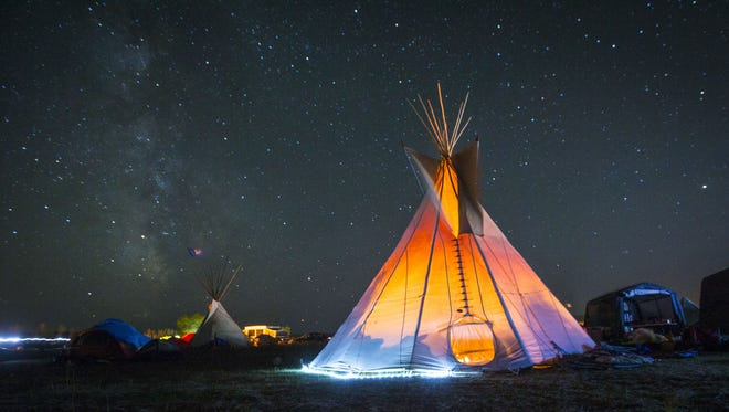 The Dakota Access pipeline passes less than 2 miles from the camp near Cannon Ball, N.D., where the International Indigenous Youth Council of Standing Rock and Oceti Sakowin Youth encampment teepee lights up under the stars Oct. 1. International Indigenous Youth Council of Standing Rock and Oceti Sakowin Youth encampment tipi at the Oceti Sakowin Camp near Standing Rock Reservation Saturday Oct. 1, 2016, near Cannon Ball, North Dakota.