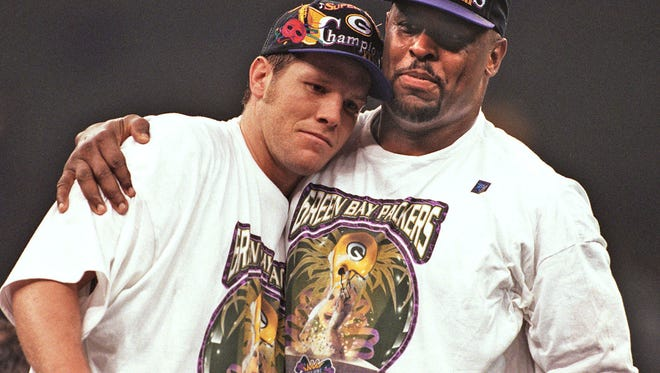 Brett Favre and Reggie White share a moment after winning Super Bowl XXXI in New Orleans.