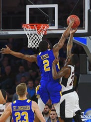 SDSU's Tevin King (2) blocks a shot by Omaha's Tra-Deon