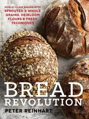 "This undated image provided by Ten Speed Press via Penguin Random House shows the cover of ""Bread Revolution"" by Peter Reinhart. The book dives into the rising trends of sprouted and whole grains, as well as heirloom flours."