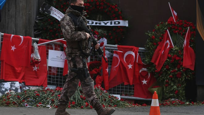 A Turkish special security force member patrols near the scene of the Reina night club following the New Year's day attack, in Istanbul, Wednesday, Jan. 4, 2017. Turkey has identified the gunman in the Istanbul nightclub massacre, the foreign minister said Wednesday as the president vowed that the country won't surrender to terrorists or become divided.