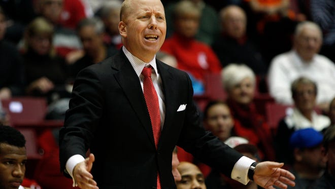 Cincinnati Bearcats head coach Mick Cronin reacts from the bench during the first half.