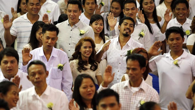 Filipino couples exchange vows during a mass wedding on Feb. 12, 2016 in Manila, Philippines. About 350 Filipino couples participated in a civil mass wedding two days before Valentine's Day officiated by former president and current Manila mayor Joseph Estrada to strengthen family ties.