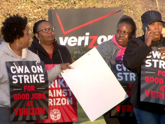 Verizon workers march on a picket line outside the Hamilton, NJ, Call Center as they kick off their strike against the company Wednesday morning, April 13, 2016.
