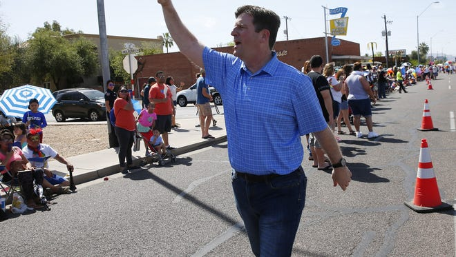 Phoenix Mayor Greg Stanton waves during the Phoenix Pride Parade in Phoenix April 8, 2018.
