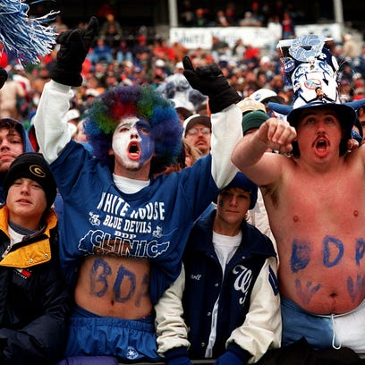 White House fans cheer on their team during a 1990s
