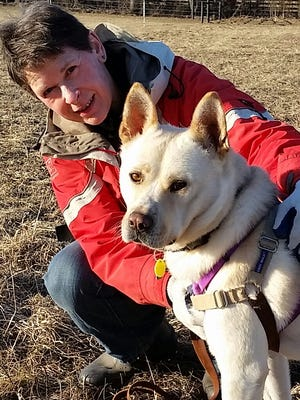Marcus, a Jindo mix, was raised on a Korean dog meet farm before arriving at the Elmbrook Humane Society. Dorothy Crockett (left) and her husband, Jock Drummond, officially adopted Marcus in February.