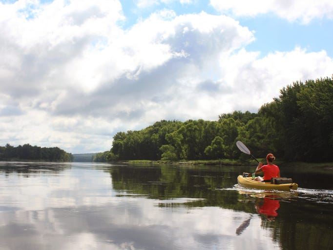 Courtney Lewis paddles down the St. Croix River north