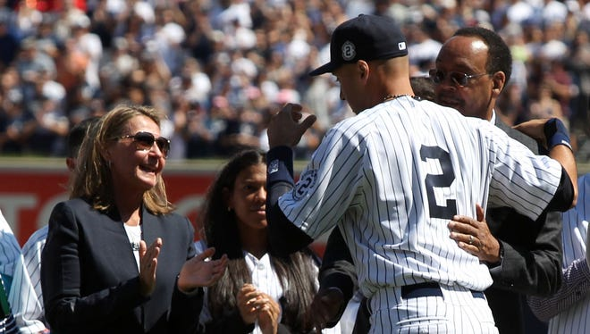 \Derek Jeter hugs his parents Charles and Dorothy during a Sept. 7 ceremony in his honor at Yankee Stadium.
