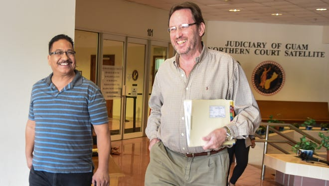In this Aug. 9 file photo former police officer Mark Charfauros, left, leaves the Judiciary of Guam Northern Court Satellite with his defense attorney, F. Randall Cunliffe, after his arraignment hearing on Wednesday, Aug. 9, 2017.