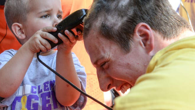 "Jack Williams, left, a cancer patient, shaves the hair off of Clemson tight end Garrett Williams during Sean Pollard's ""All Off for Cancer"" event at the Allen N. Reeves Football Complex in Clemson on Wednesday. The event is in conjunction with the Clement's Kindness Fund for Children and raises money for families impacted by pediatric cancer."