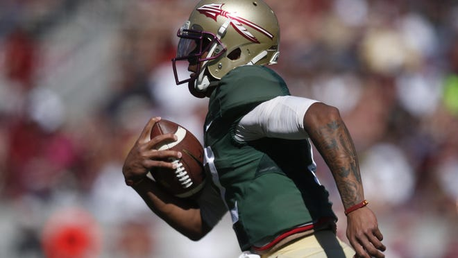 FSU's Deondre Francois breaks off a long run during the Garnet and Gold game in April. He had scrambles of 20 and 25 yards in the contest.